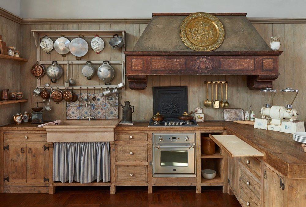 Arredamento rustico tutto sulle cucine l 39 eco di parma for Arredamento case rustiche